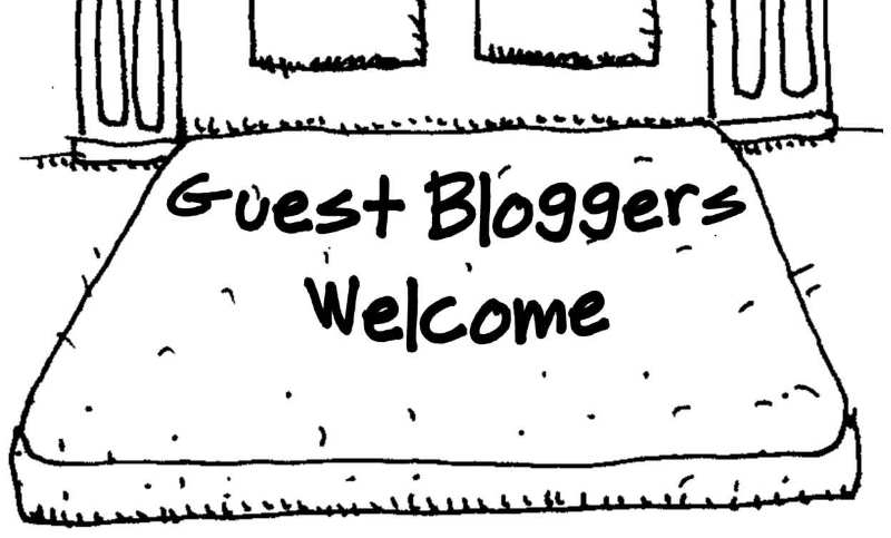 guest bloggers welcome sign featuring a bed on the floor