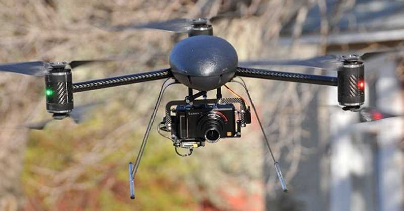 drone flying with camera attached