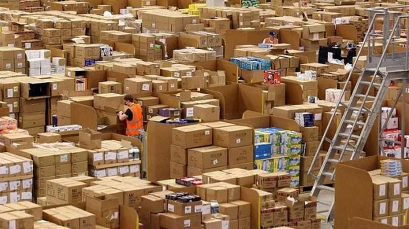 warehouse full of box and employees working