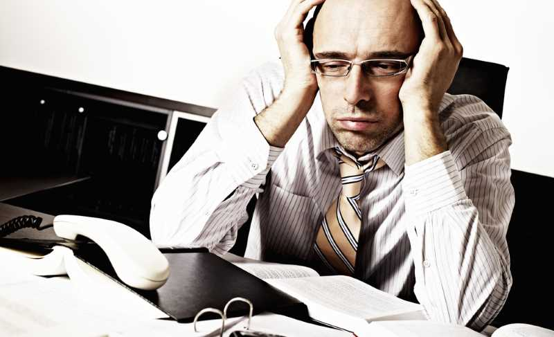 price of being an entrepreneur, man with his head in his hands, tired
