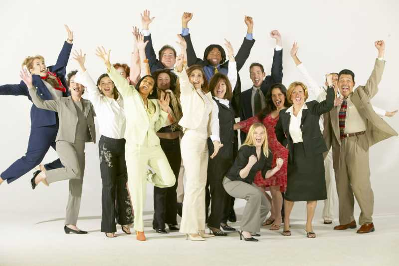 unusual way to motivate employees, group of employees happy and jumping