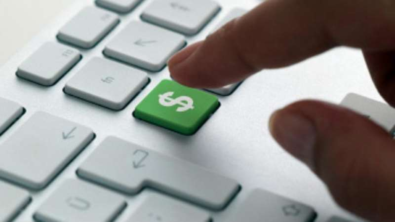 funding, finger typing on a green dollar key on a keyboard