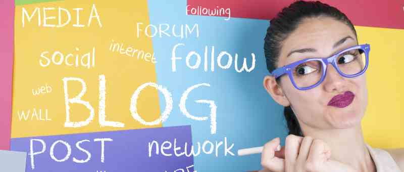 How to Start a Blog - Start Blogging - Step-by-Step Guide - lady with purple glasses in front of colorful board with blog related terms