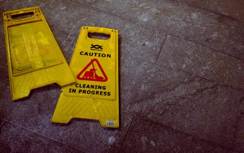 broken cleaning in progress yellow sign on the floor