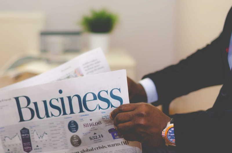 businessman reading financial newspaper