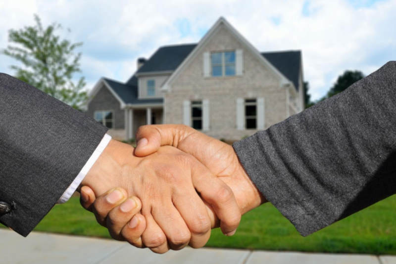 hand shake in front of property
