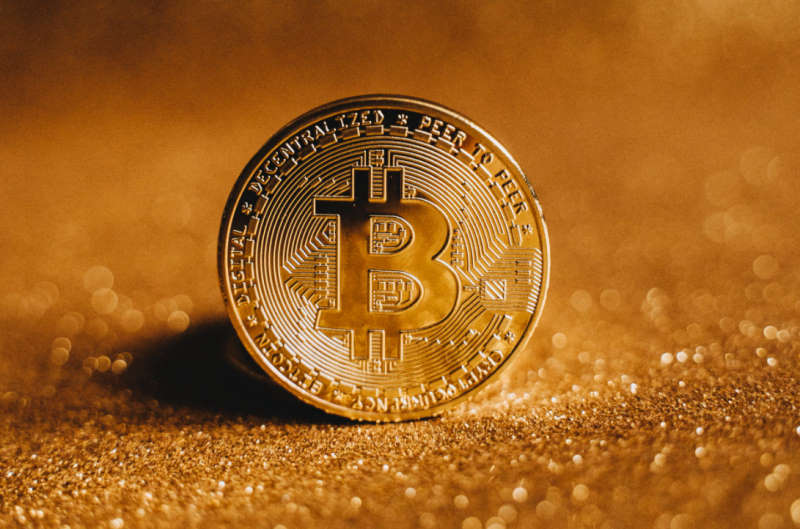 bitcoin on gold background