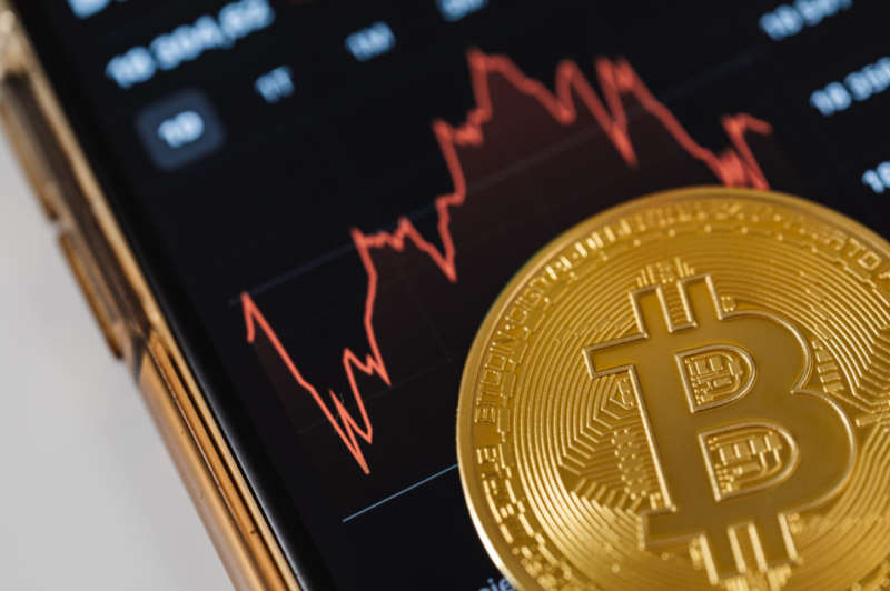 bitcoin on a phone with stock chart