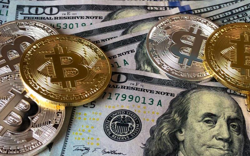 bitcoins and us dollar banknotes