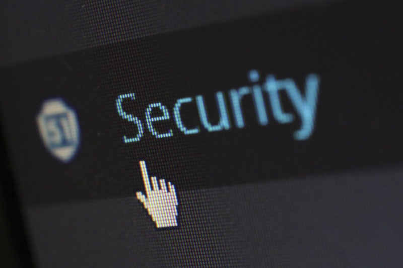 cursor in hand shape on the word security on a screen