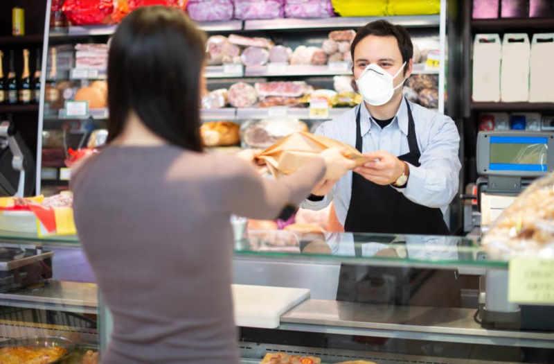 shop employee attending client