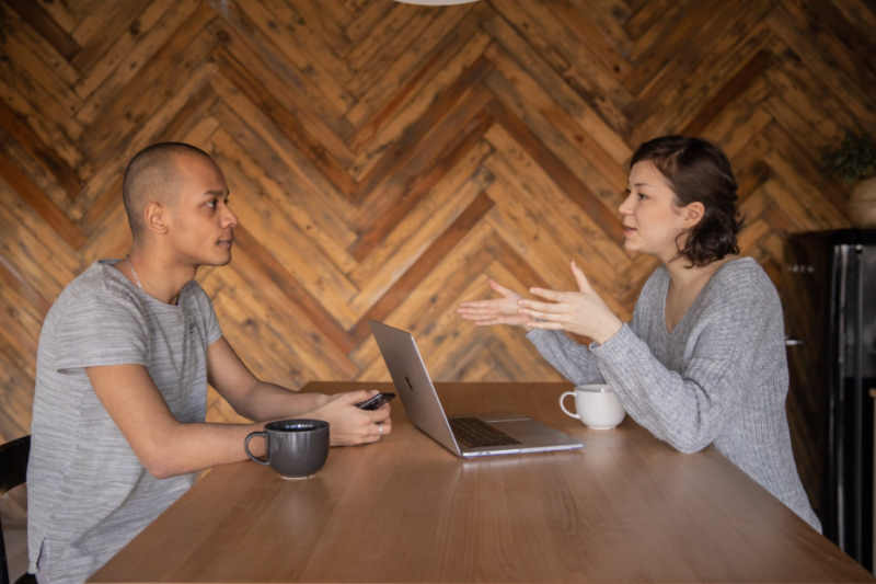 2 people discussing at meeting table