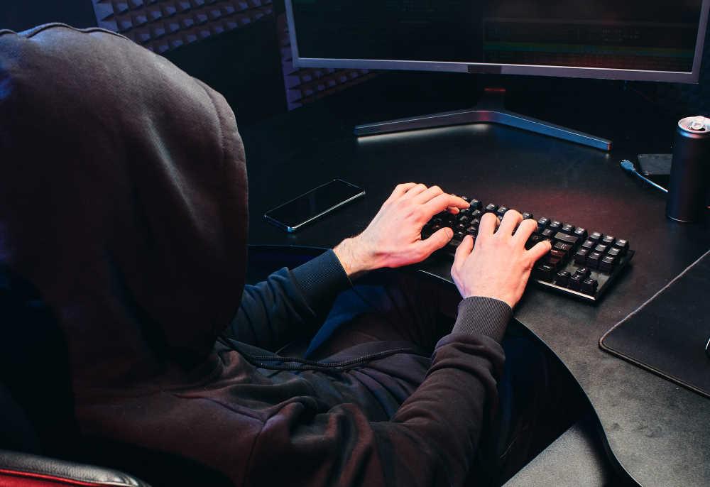 hacker keying on keyboard