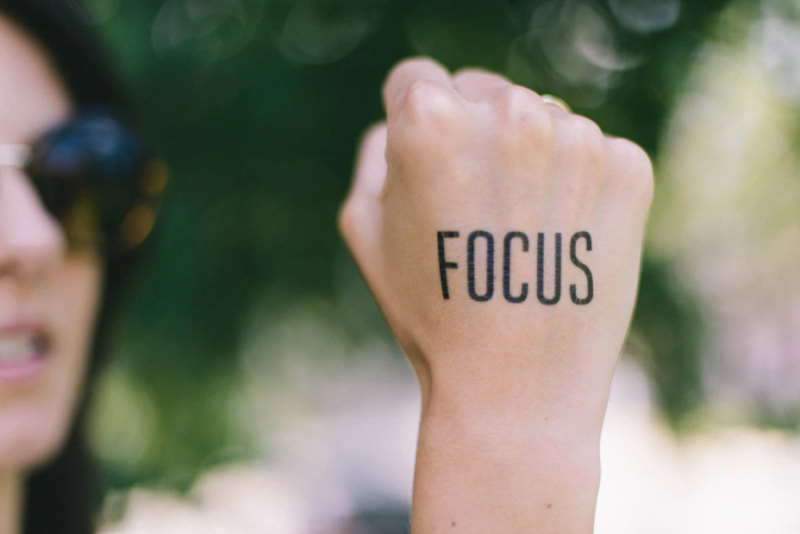 woman with the word focus on her fist