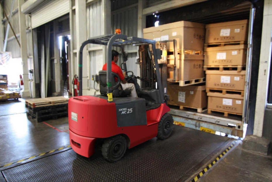 fork lift unloading goods